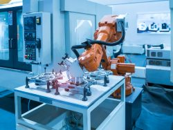 Robotic cells for loading and unloading machine tools of all kinds