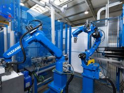 Multi-robot systems managing automatic unloading of production machine, test-check and storage of the processed piece.